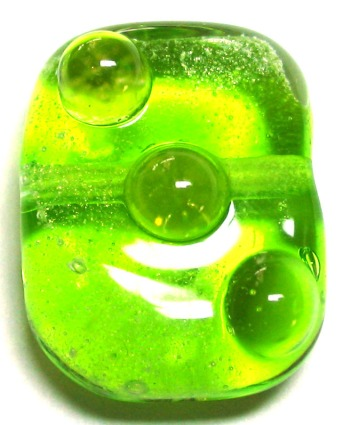 tab lime green with gold dust and light amber dots